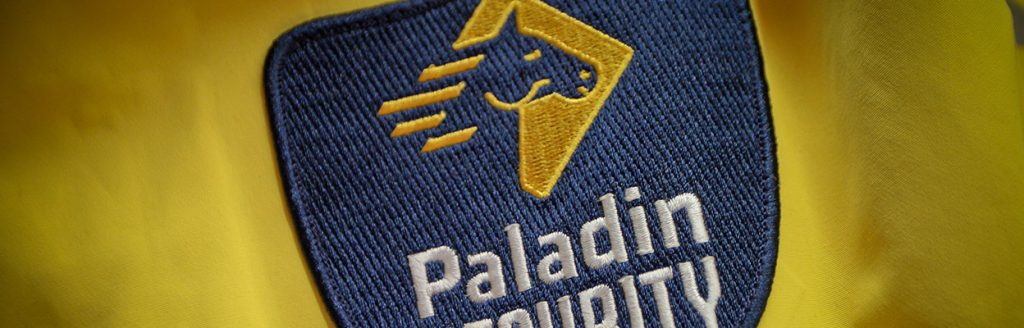 https://paladinsecurity.com/wp-content/uploads/2016/11/paladin-security-badge.jpg
