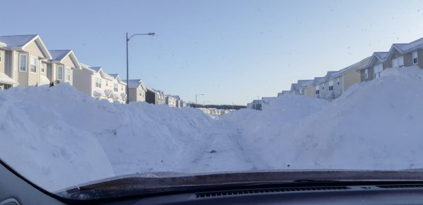 Huge Snow Piles in Residential Area