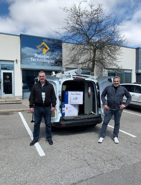 Iain Morton and Nick Tsigaridas standing by van